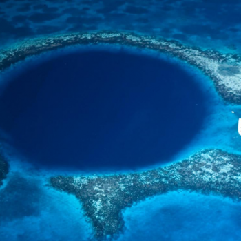 Blue circle of water surrounded by reefs